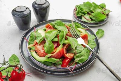 Salmon avocado salad, beet leaves, radicchio, tomatoes, lemon and olive oil dressing