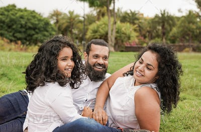 Indian family enjoy day at city park - Hindu father, mother and son outdoor