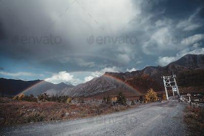 Double rainbow in mountain settings