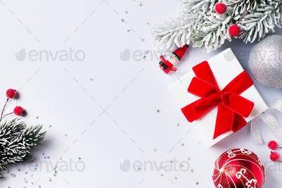Christmas gift box flat lay on white background with decoration.