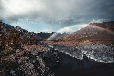 Double rainbow over a mountain river