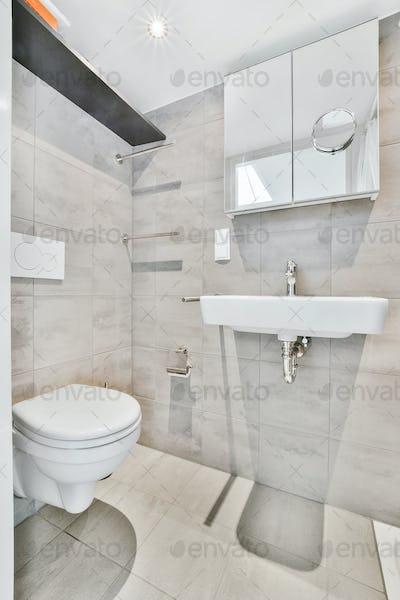 Gray tiled shower in bathroom