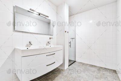 Bathroom with white tiled walls