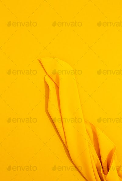 Minimal stylish wallpaper. Yellow textile silk and yellow background. Trendy colours