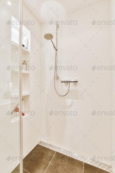 Shower tap in tiled bathroom