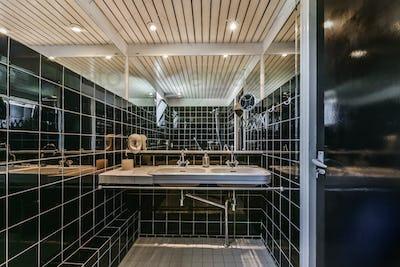 Interior of white modern bathroom in apartment