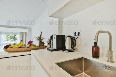 Modern washbasin under counter in kitchen