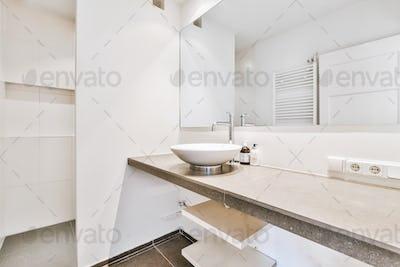 Sink in modern bathroom at home