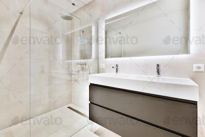 Sink and mirror near shower