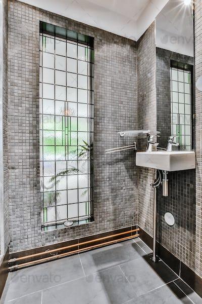 Modern bathroom with gray tiled walls