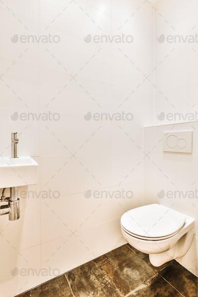 Toilet and sink in modern restroom