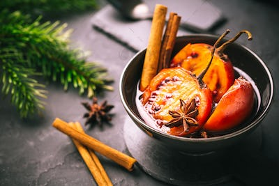 Christmas dessert - flamed tamarillo in hot wine punch with cinnamon and anise