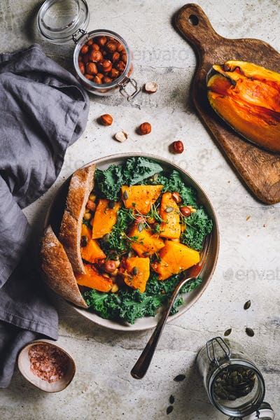 Season salad with grilled pumpkin, kale, chickpea, pepitas and nuts