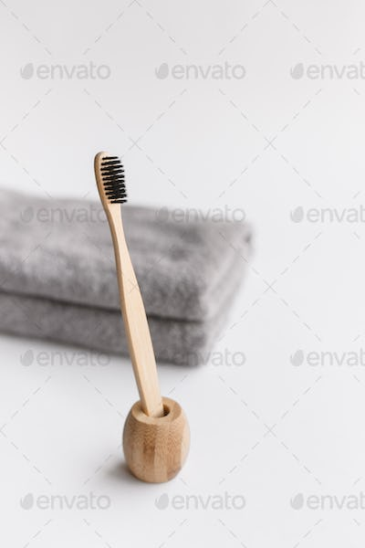 Wooden bamboo toothbrushes on white background
