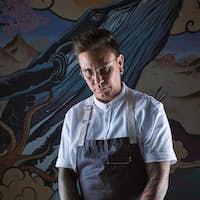 Chef with apron cutting fresh bluefin tuna loin