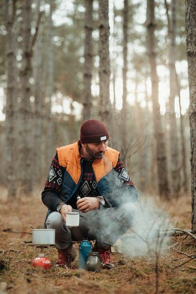 Hiker man in the campsite