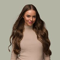 Beautiful woman with long hair beauty healthy skin natural make up. Color background green