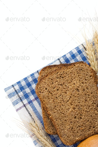 rye bread and ears of wheat