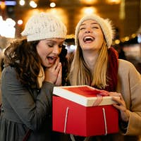 Portrait of happy women exchanging christmas presents. Holiday people christmas happiness concept