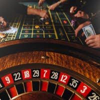 Casino theme. Pocker game. Unrecognizable gamblers play casino on money. Pocker cards and chips