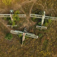 Old abandoned airfield with abandoned planes. Aerial view.