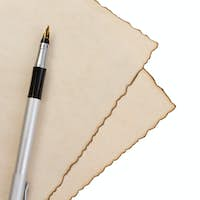 pen on parchment isolated at white