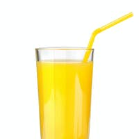 Orange juice in a glass isolated on a white