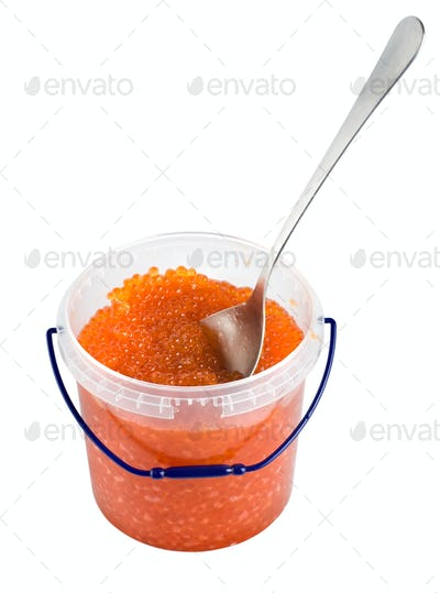Red caviar in a plastic container isolated