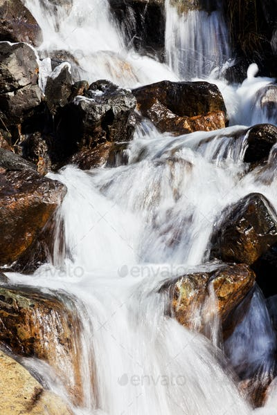 Small mountain torrent with clear fresh water