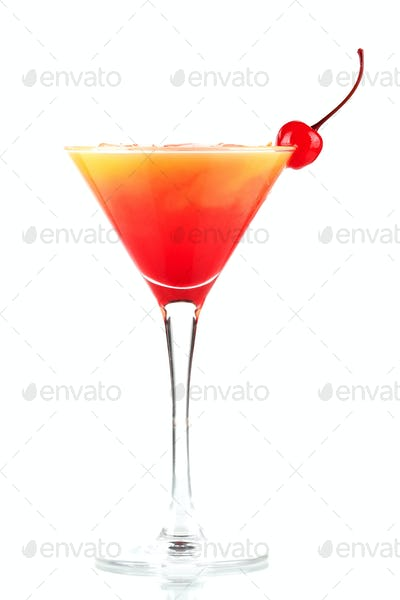 Tequila sunrise alcohol cocktail with ice and maraschino