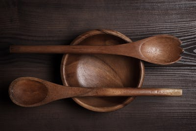 Empty Salad Bowl And Two Spoons On Wooden Table