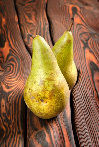Two pears on an old wooden background