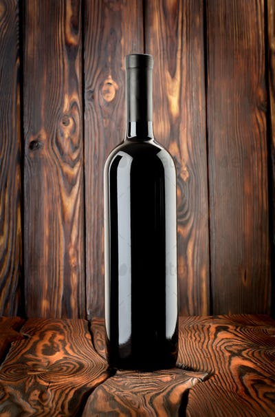 Bottle of red wine on the table