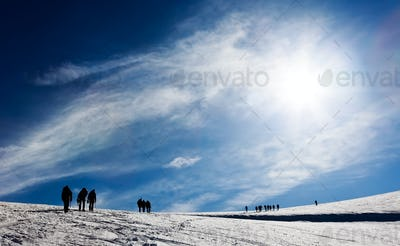 Mountaneers walking on a glacier