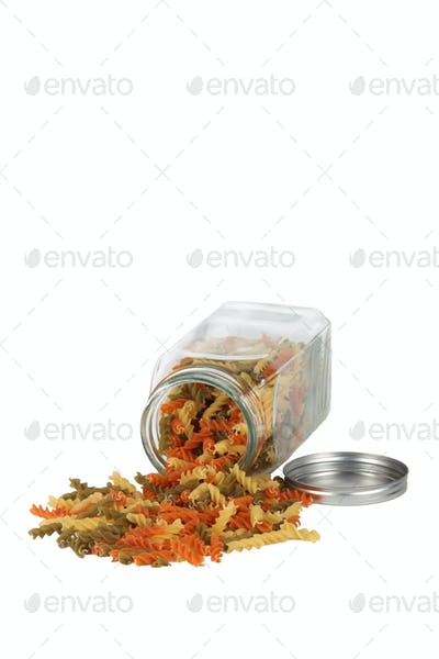 Dried pasta spilling from jar