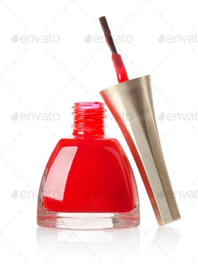 Red nail polish and brush isolated