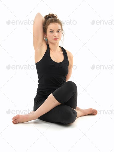 white woman in sitting yoga pose