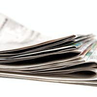 Stack of newspapers.