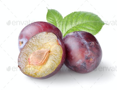 Three plums with leaves