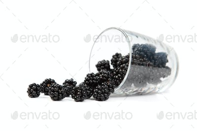 Blackberries a scattered from a glass