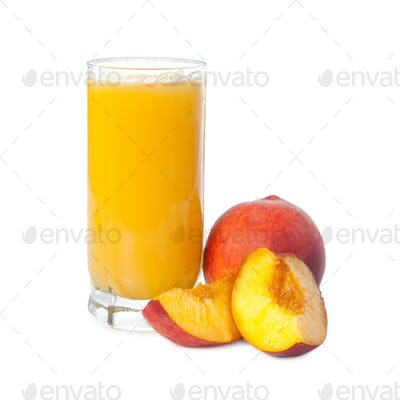 A glass of peach juice with fruits