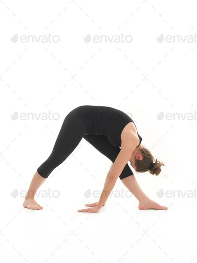 young woman demonstrating begginer yoga pose