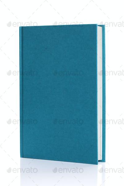 Isolated blank blue hardback book