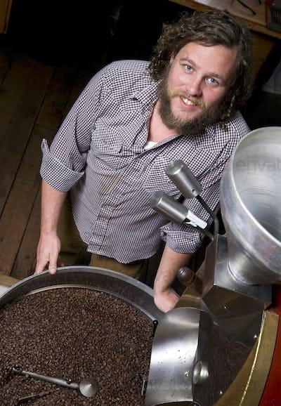 Master Roaster Monitors Coffee Bean Roasting