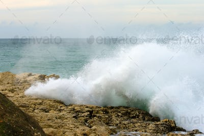 Big wave shattered on the rocks