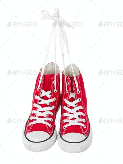 Hanging red sneakers front view