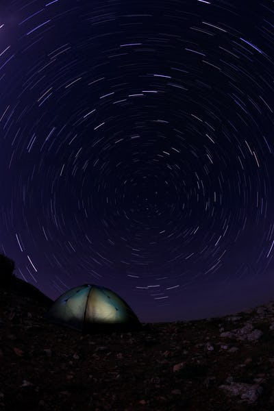 Tourist tent in the night sky