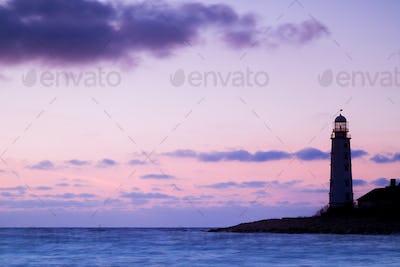 Seascape and the lighthouse on the coast