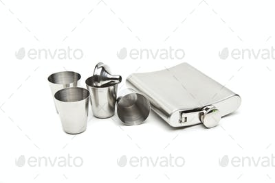Hip flask and cups with white background