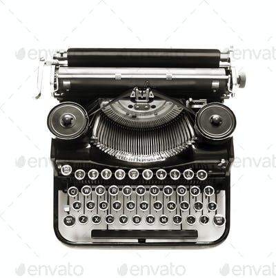 Antique typewriter a white backdrop.